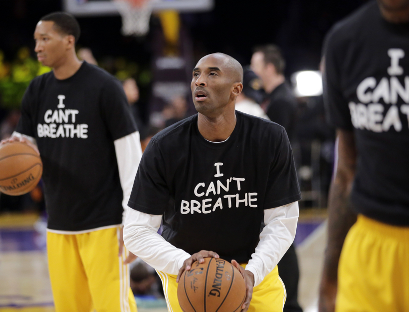 Kobe Bryant and Lakers Wear I Can't Breathe Shirts in 2014 supporting the family of Eric Garner, who died July 17, 2014 after a police officer placed him in a chokehold when he was being arrested for selling individual cigarettes.